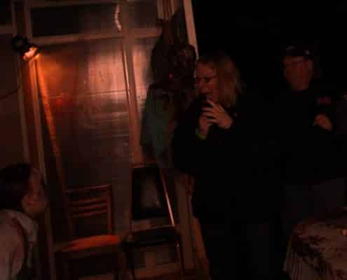 a scared tourist in the haunted house